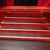 Steps featured in the set at Albert Halls, Bolton, that were clad in red Joelflex Carpet.