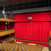J&C Joel dressed the art centre's stage with a pelmet and front of house curtain set in striking scarlet Velvet Velour.